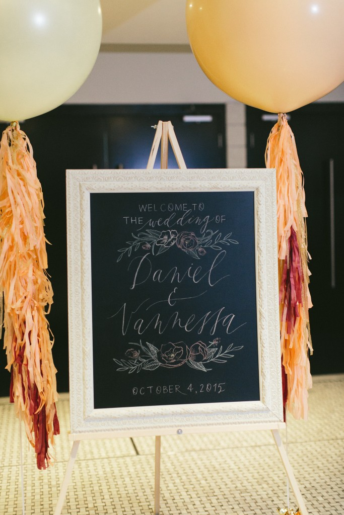 Wedding Day Stationary idea from a Sophisticated Garden-Inspired Wedding in Toronto at the Grand Luxe - Modern Chalk Calligraphy sign with big balloons
