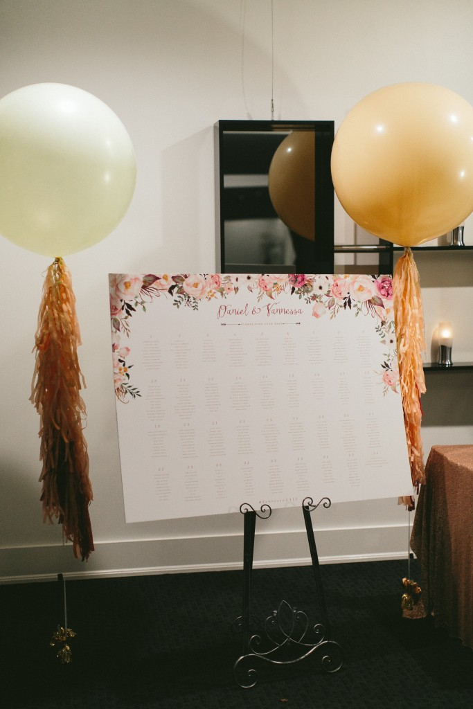 Wedding Day Stationary idea from a Sophisticated Garden-Inspired Wedding in Toronto at the Grand Luxe - Seating Chart with big balloons
