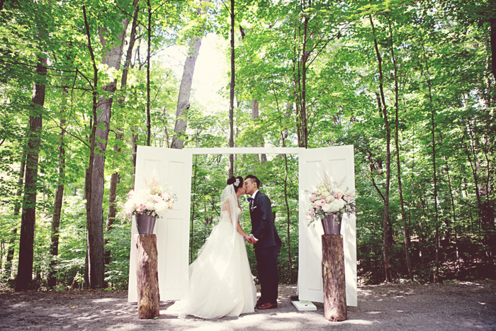 Door frame backdrop for an outdoor wedding at Kortright Centre. See more of this quirky wedding at www.rebeccachan.ca