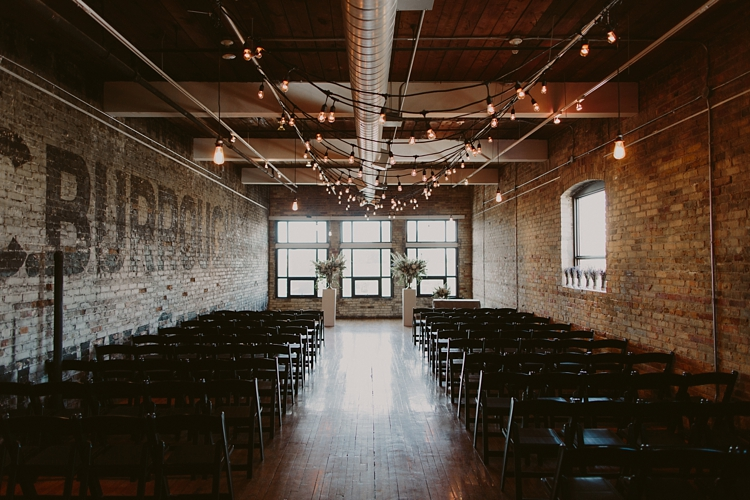 Ceremony - Intimate Burroughes Building wedding with string lights and lavender