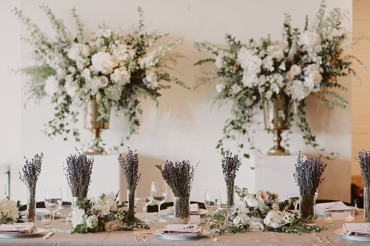 Intimate Burroughes Building wedding with string lights and lavender