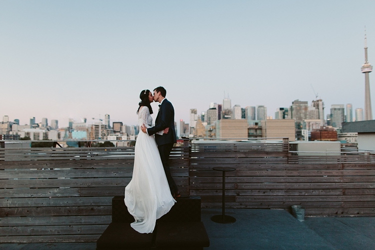 Rooftop - Intimate Burroughes Building wedding with string lights and lavender