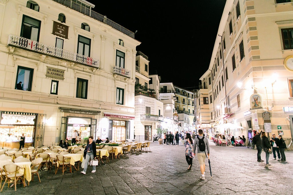 Romantic Amalfi Coast Honeymoon Ideas - Amalfi at night. Photo: Joee Wong Photography, As seen on www.rebeccachan.ca