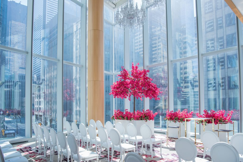 Fuschia and red bouganvillea tree decor and white Louis chairs at Shangri-La Toronto
