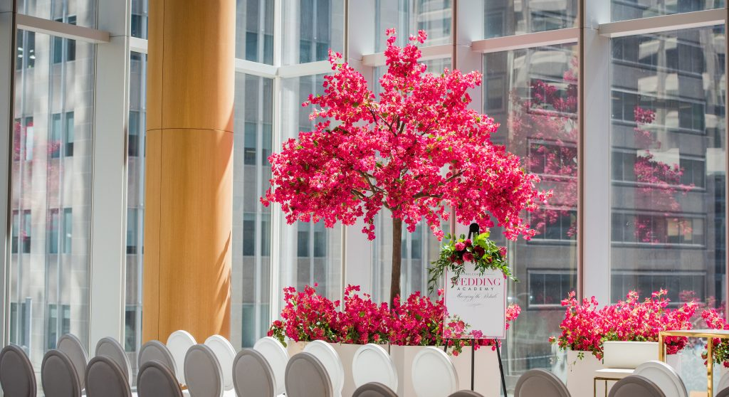 Fuschia and red bouganvillea tree decor from Rachel A. Clingen and white Louis chairs at Shangri-La Toronto