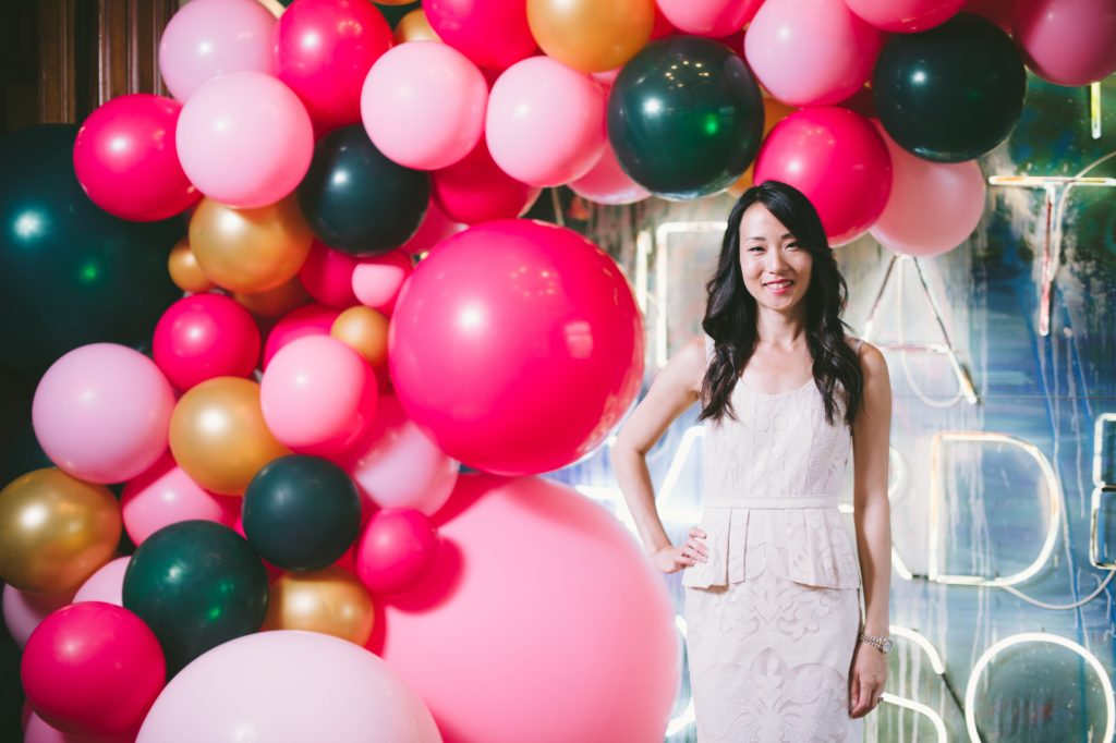 Private party for Rupi Kaur - jewel toned balloon spill