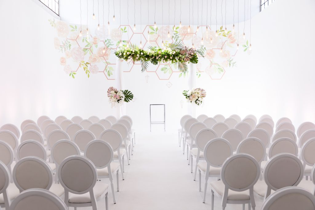 Modern Industrial Wedding Ceremony with Wall Vinyl and Hanging String Lights at District28