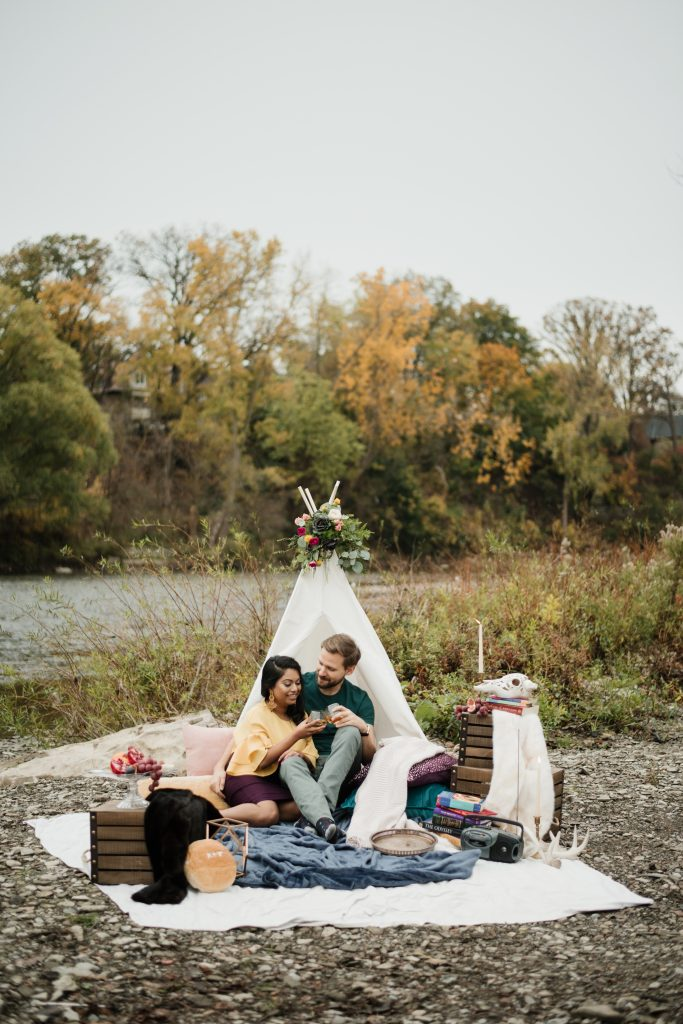 Romantic engagement shoot in a canoe with a dog