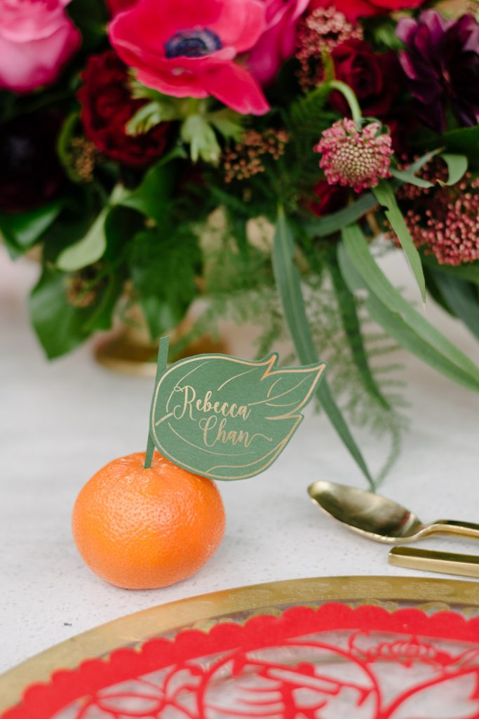 Custom leaf name card on mandarin orange - Chinese New Year decorating ideas as seen on Breakfast Television with Rebecca Chan Weddings and Events www.rebeccachan.ca