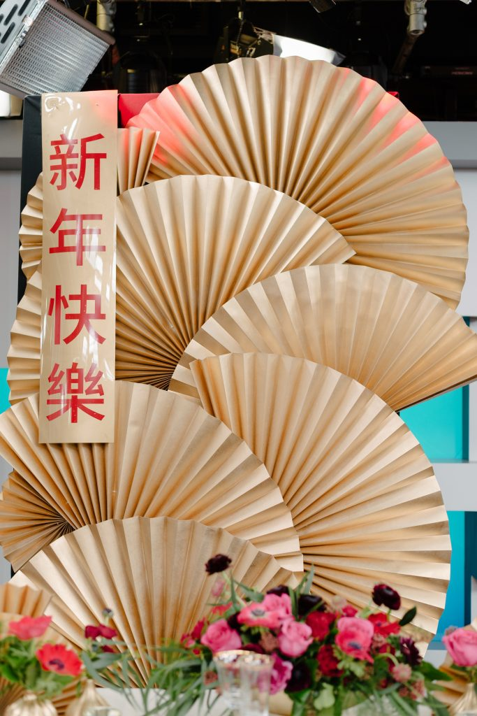 Gold Chinese fan backdrop - Chinese New Year decorating ideas as seen on Breakfast Television with Rebecca Chan Weddings and Events www.rebeccachan.ca