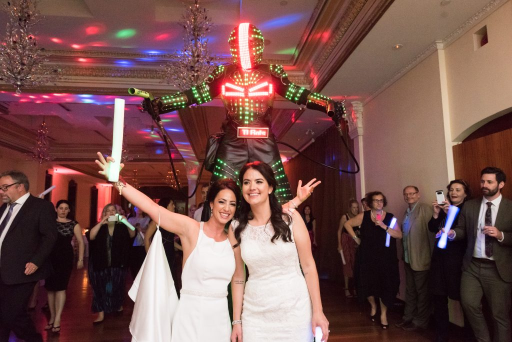 Elegant wedding with two brides and a robot at Rosewater Room