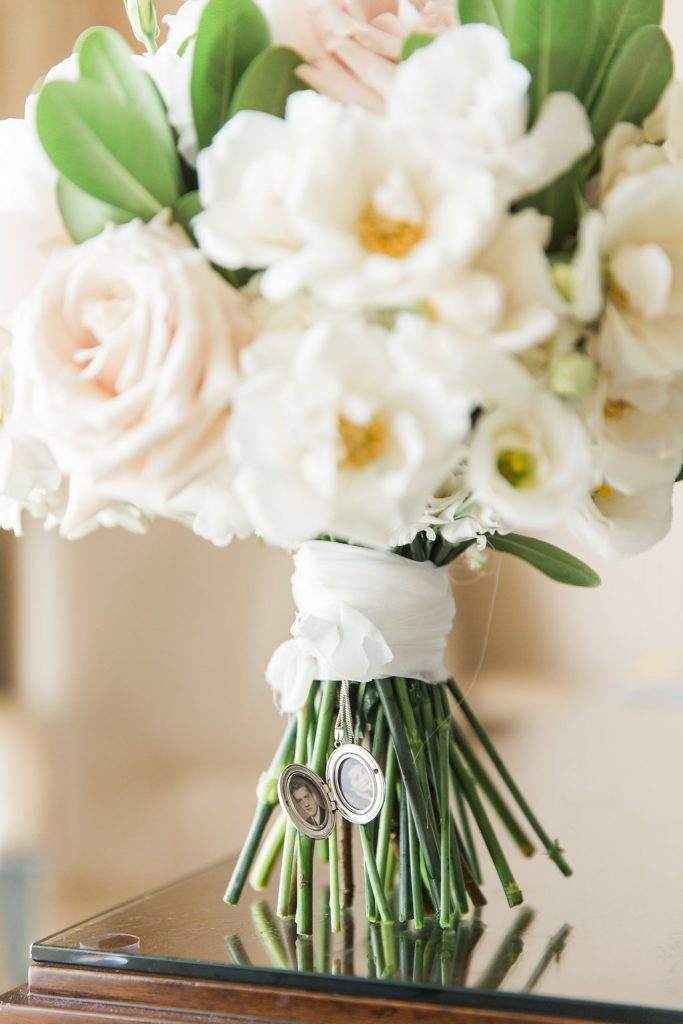 White bridal bouquet with locket