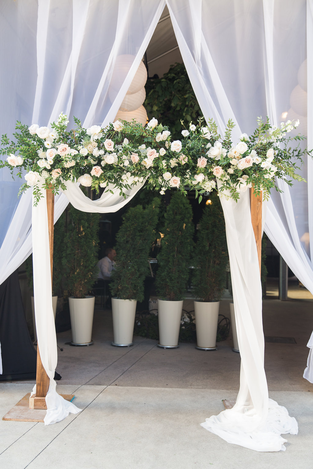 Romantic Urban Toronto Restaurant Wedding - Garden inspired floral arch