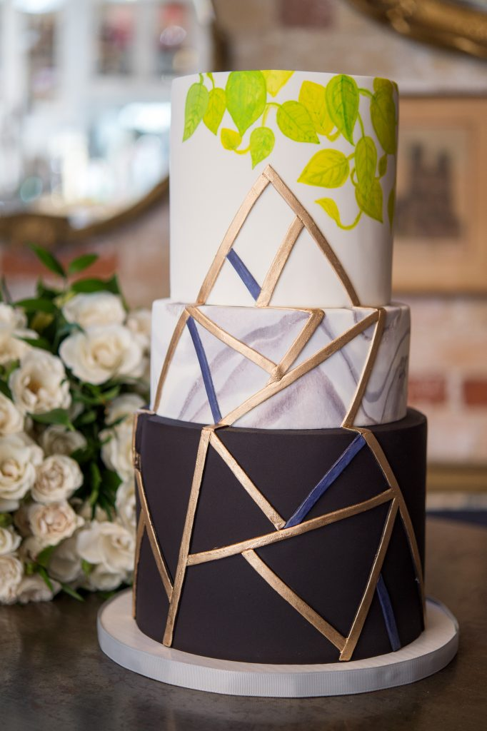 Geometric black and foliage inspired wedding cake