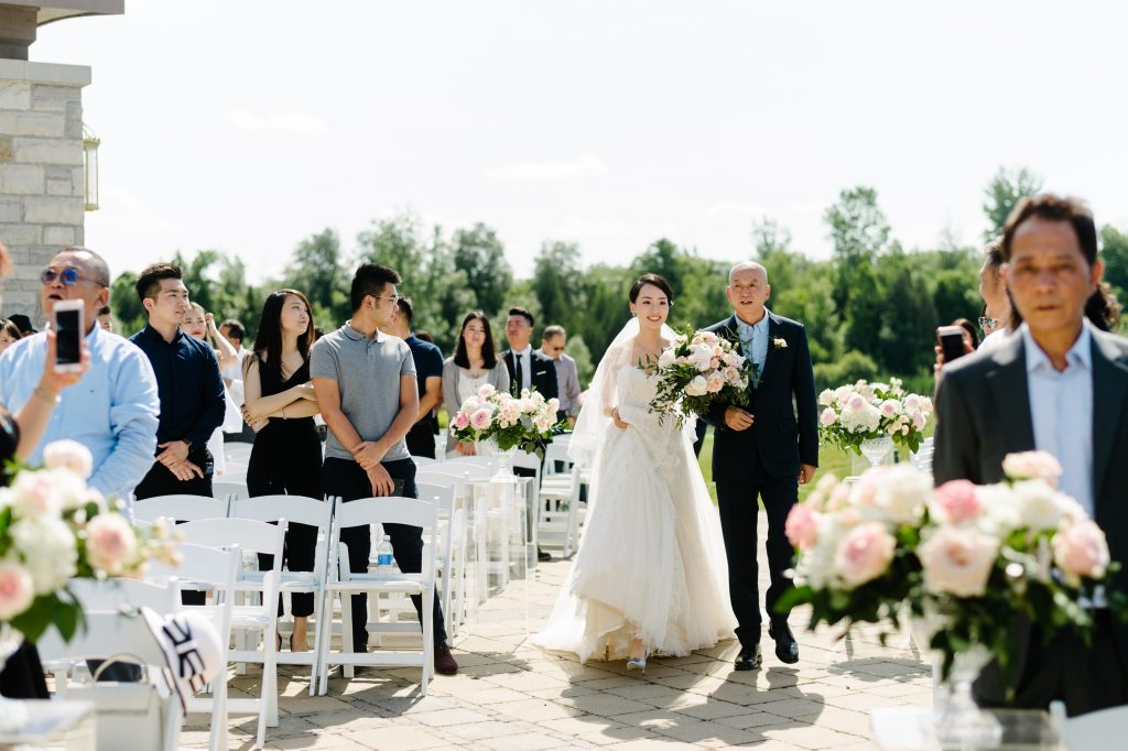 Luxurious blush garden wedding ceremony at Eagles Nest Golf Course