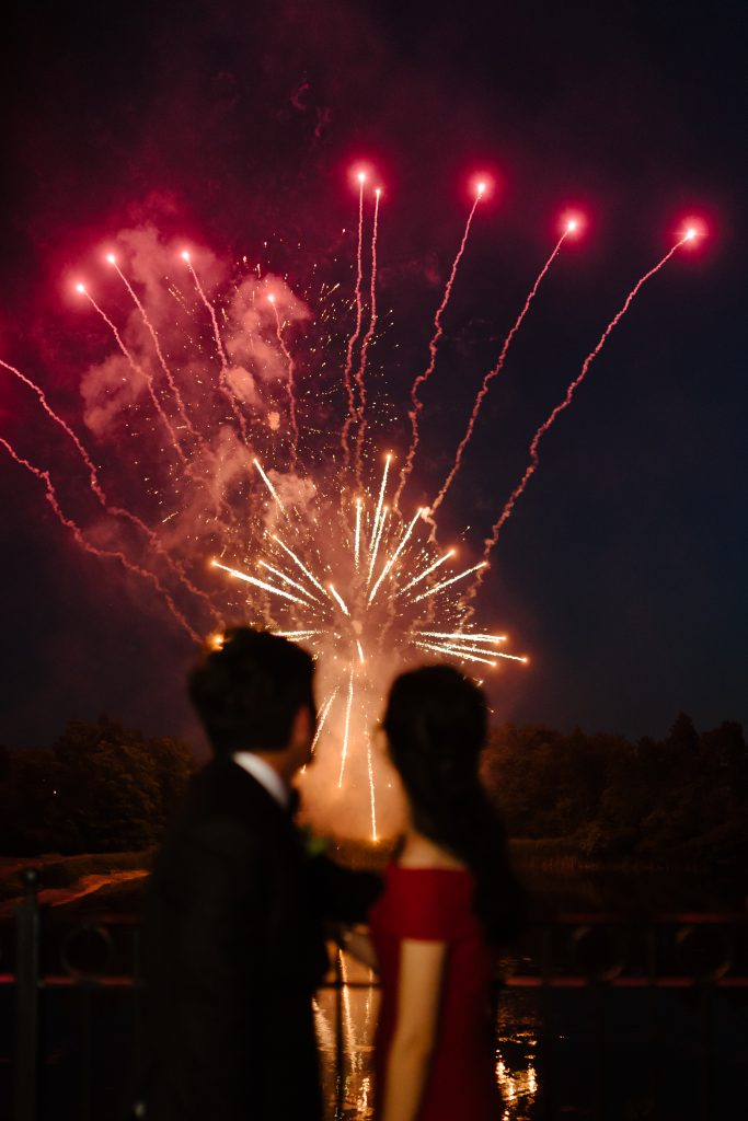 Fireworks at a luxurious blush garden wedding at Eagles Nest Golf Course