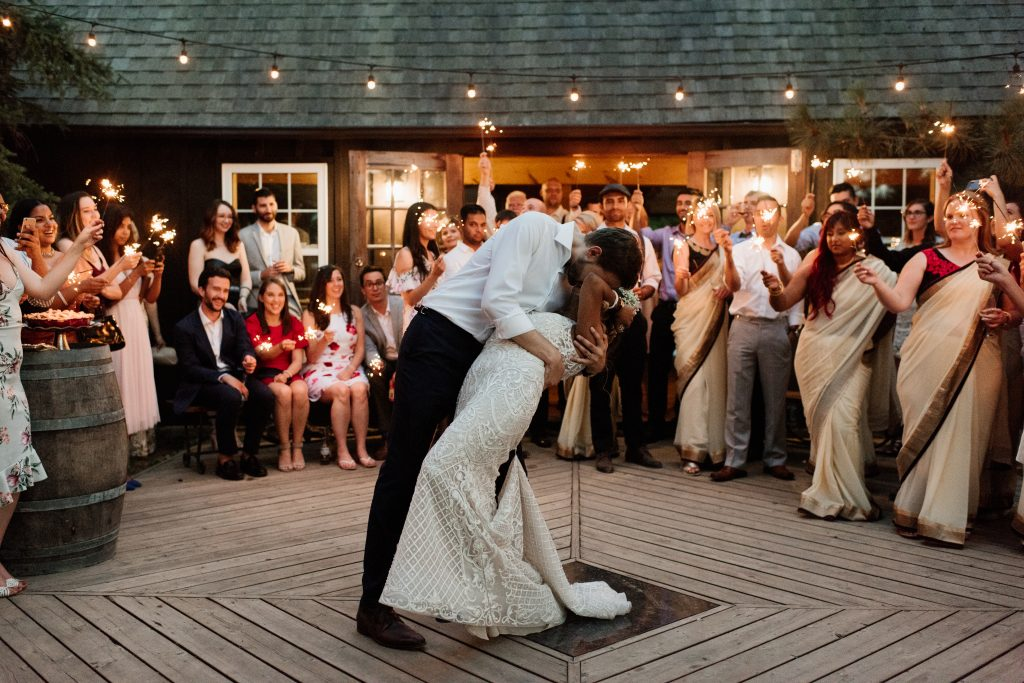 Outdoor First Dance under string lights at Kurtz Orchards Farm Wedding