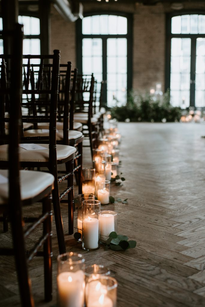Storys building wedding reception with candles
