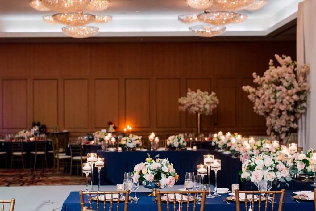 Navy linen and blush flowers at Shangri-La Hotel Toronto Queen's Park Ballroom