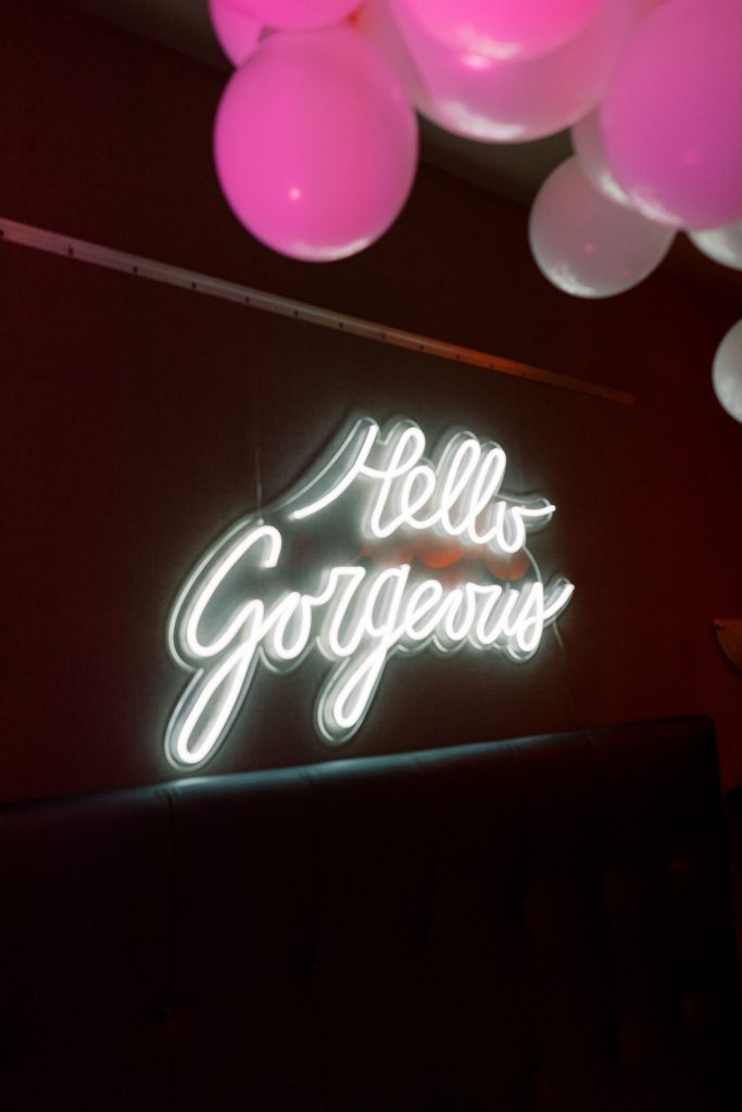 Neon sign for Hello Gorgeous, in the Electric Bedroom photobooth