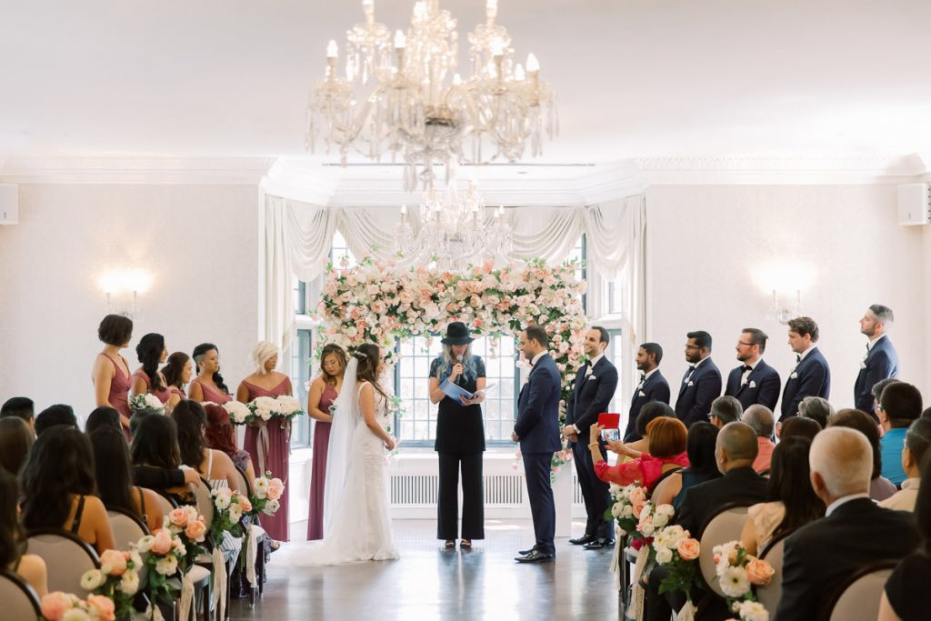 Blush and coral wedding ceremony at Estates of Sunnybrook