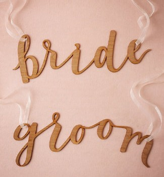 Calligraphy bride and groom chair signs