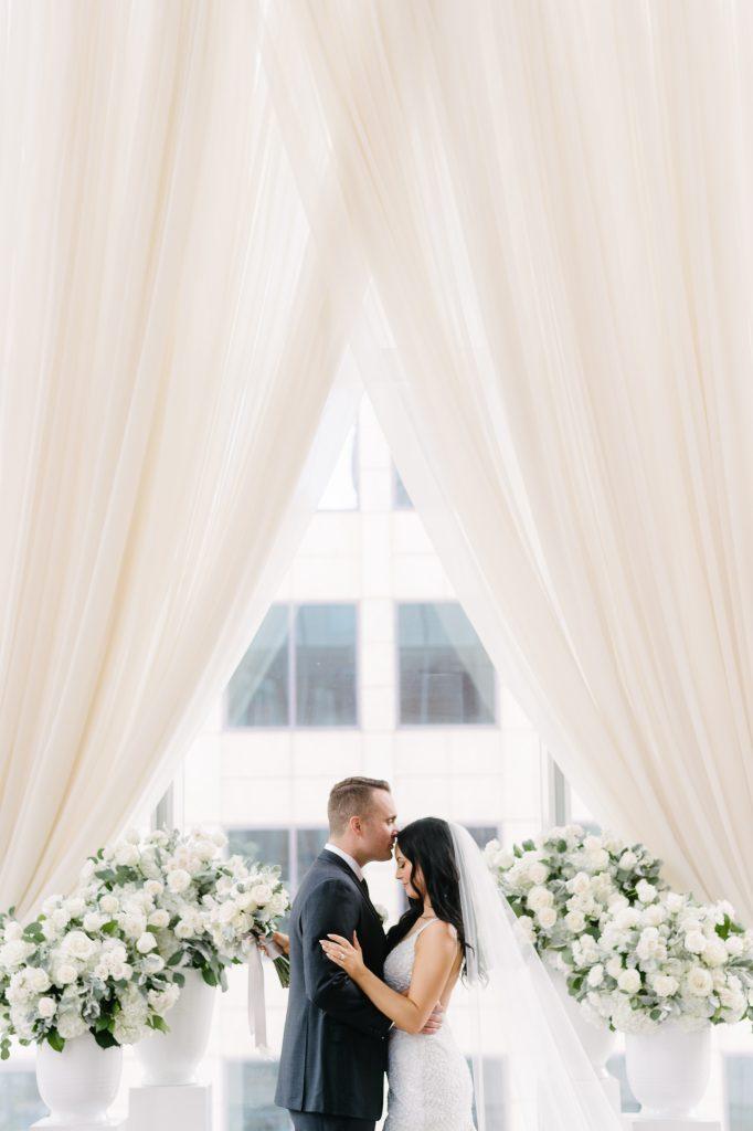 Classic white wedding ceremony at Shangri-La Hotel Toronto