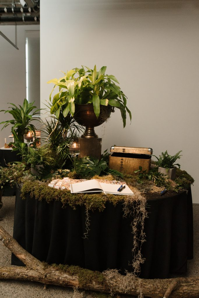 Welcome table at an urban jungle wedding reception at the Museum of Contemporary Arts