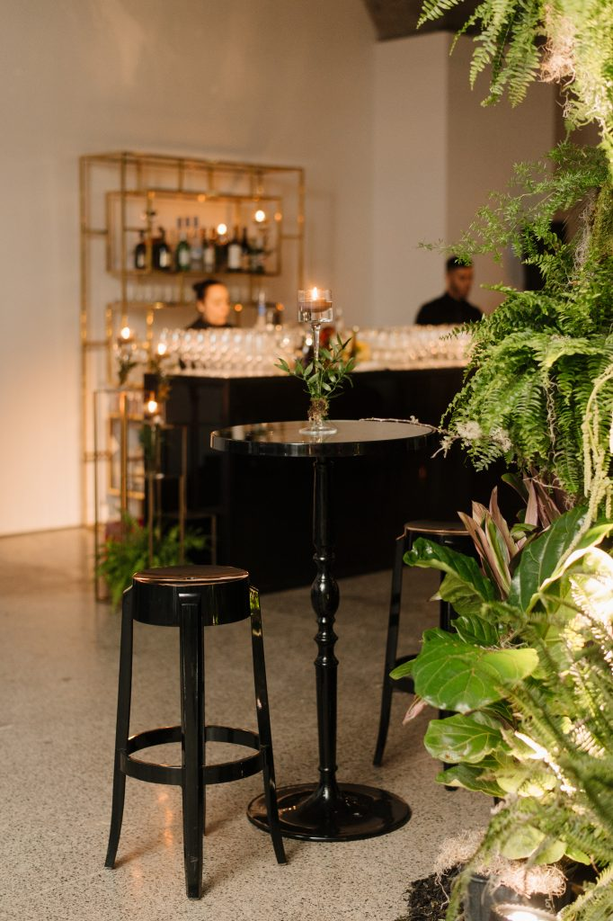 Modern black furniture at an urban jungle wedding reception at the Museum of Contemporary Arts