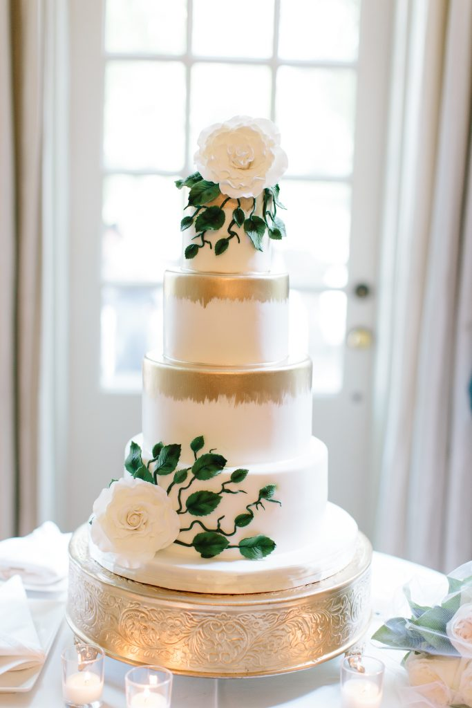 White wedding cake with gold details at Graydon Hall Manor