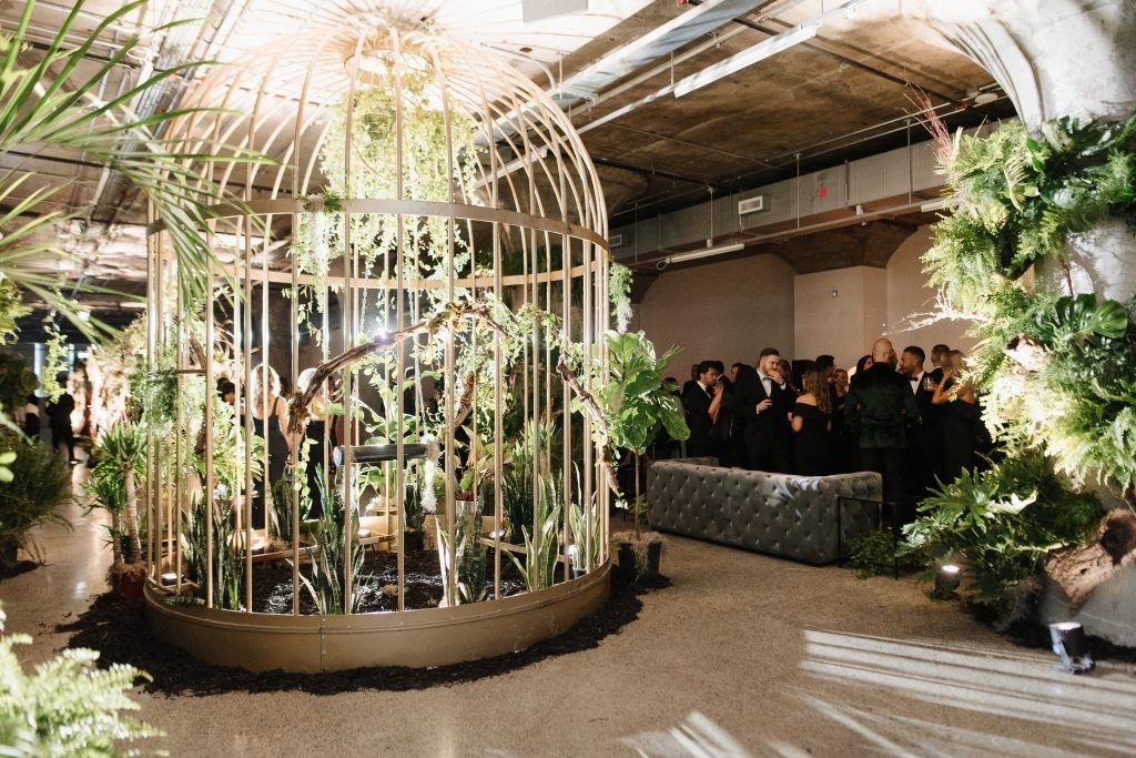 Modern black and green urban jungle wedding reception at the Museum of Contemporary Arts