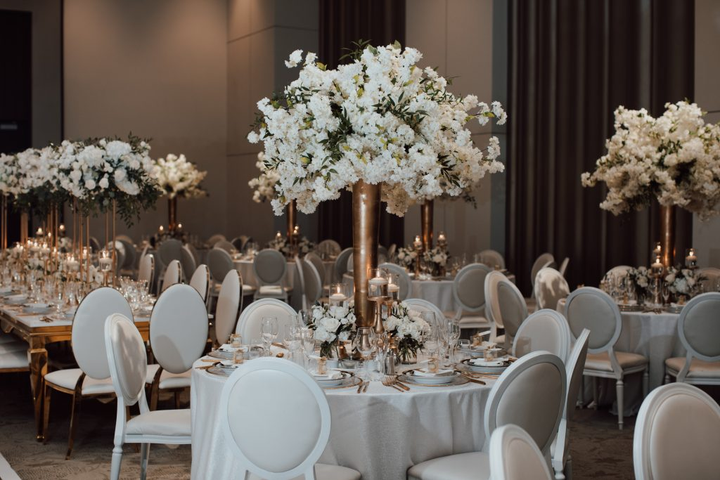 A luxurious white wedding with chery blossoms for NHL player Mike Hoffman wedding.