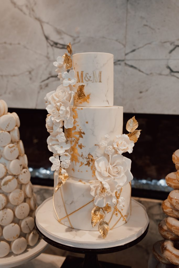White and gold sweets table and wedding cake