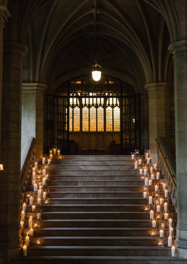 Candlelit stairwell - Modern luxurious all white wedding at Knox College Chapel. Planned by Rebecca Chan Weddings & Events. www.rebeccachan.ca